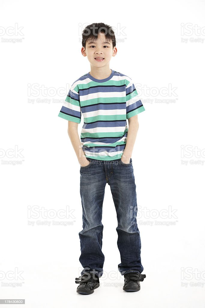 Full Length Studio Shot Of Chinese Boy stock photo