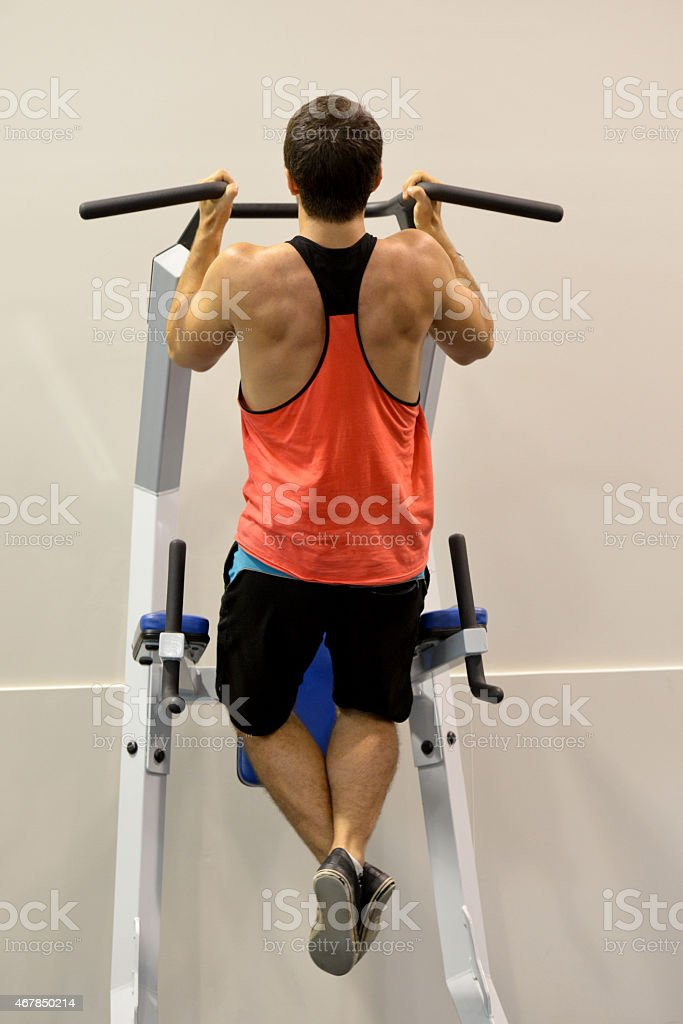 Full length view of a male doing pull ups stock photo