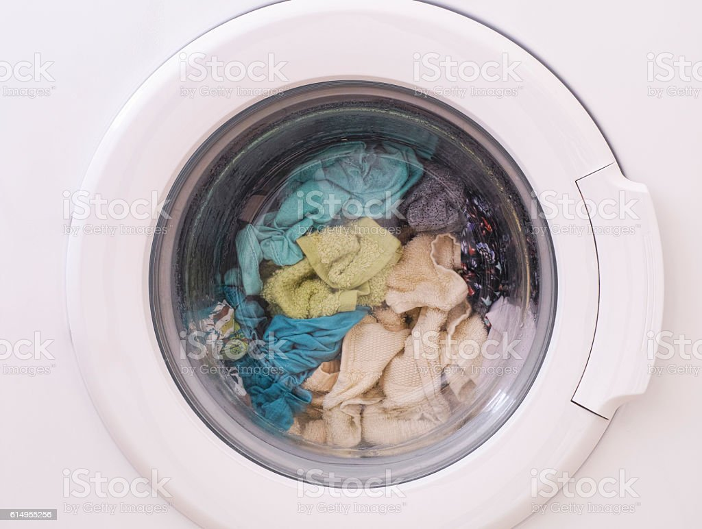 Full loaded washing machine stock photo
