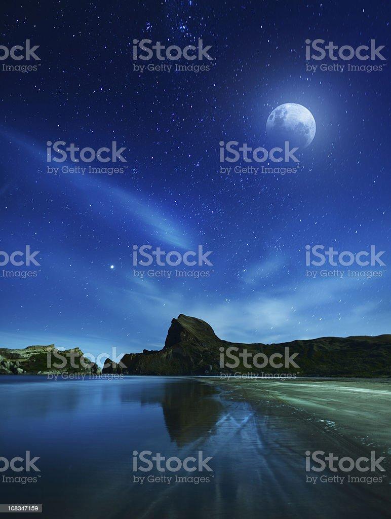 Full moon and rocky coast stock photo