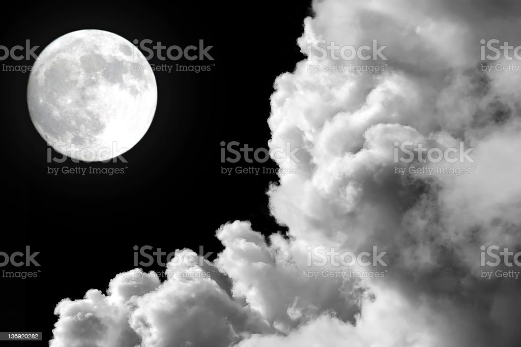 full moon and storm clouds stock photo