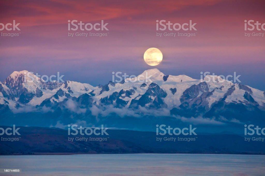 Full moon at Lago Titikaka with Cordillera Real Bolivia stock photo