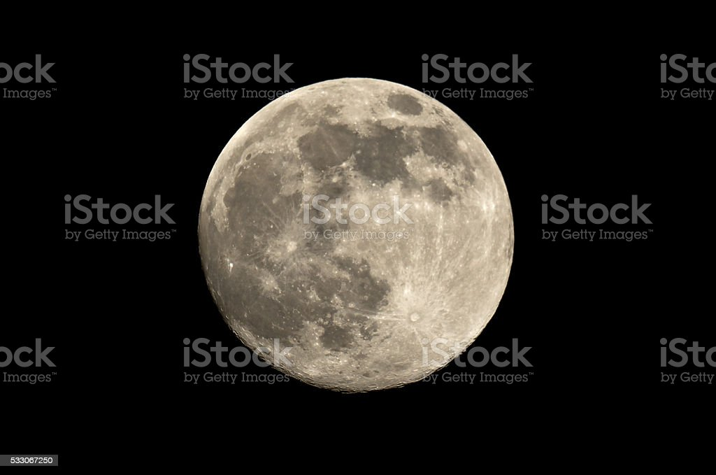 full moon at night spends in the sky stock photo