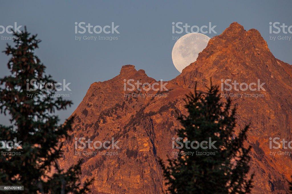Full Moon at Sunrise stock photo