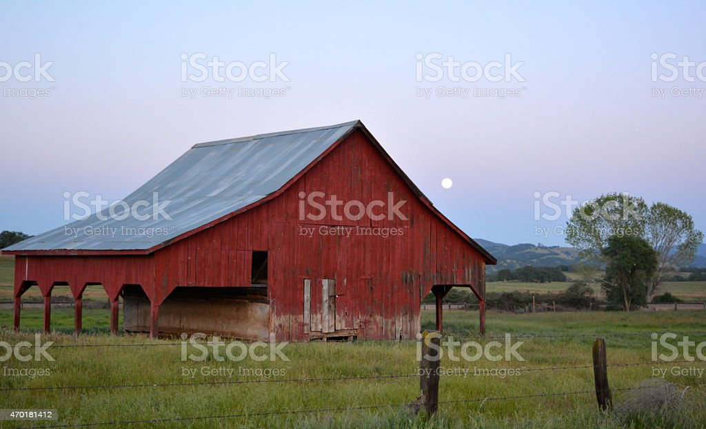 Full Moon Behind Barn stock photo