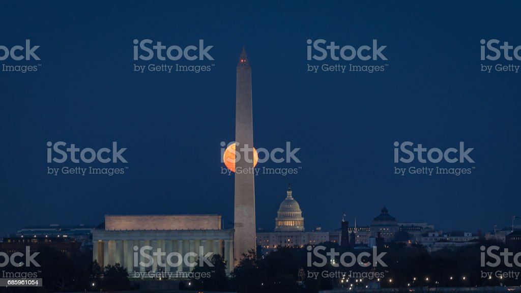 Full Moon Behind Monument stock photo