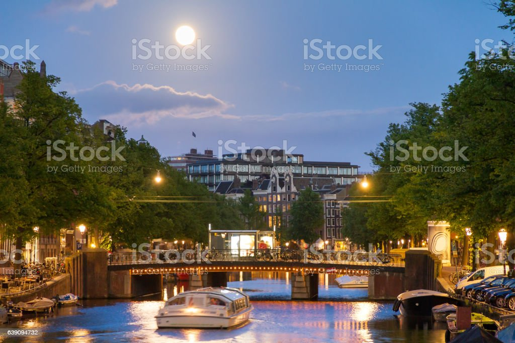 Full moon canalboat stock photo