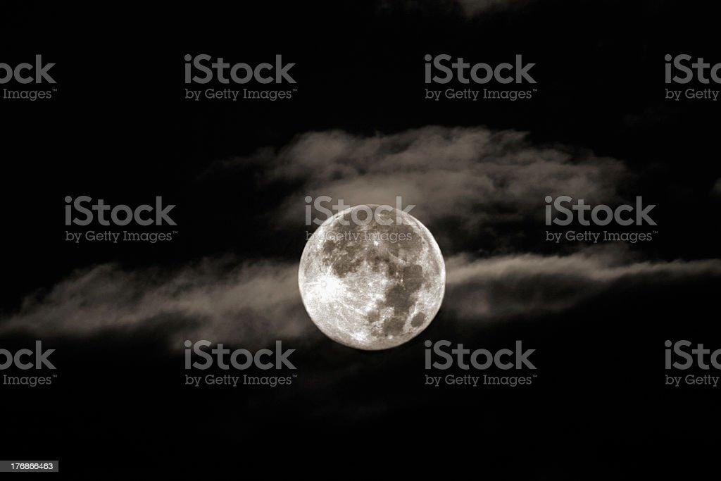 Full moon high in the night sky stock photo