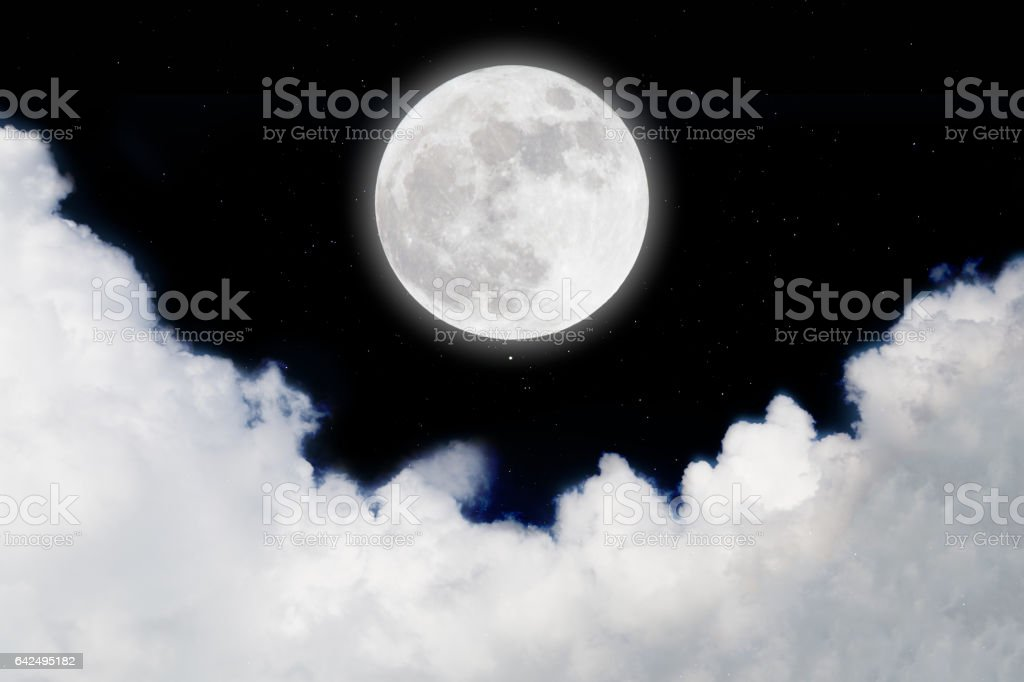 full moon in space over stars with cloudscape background. stock photo