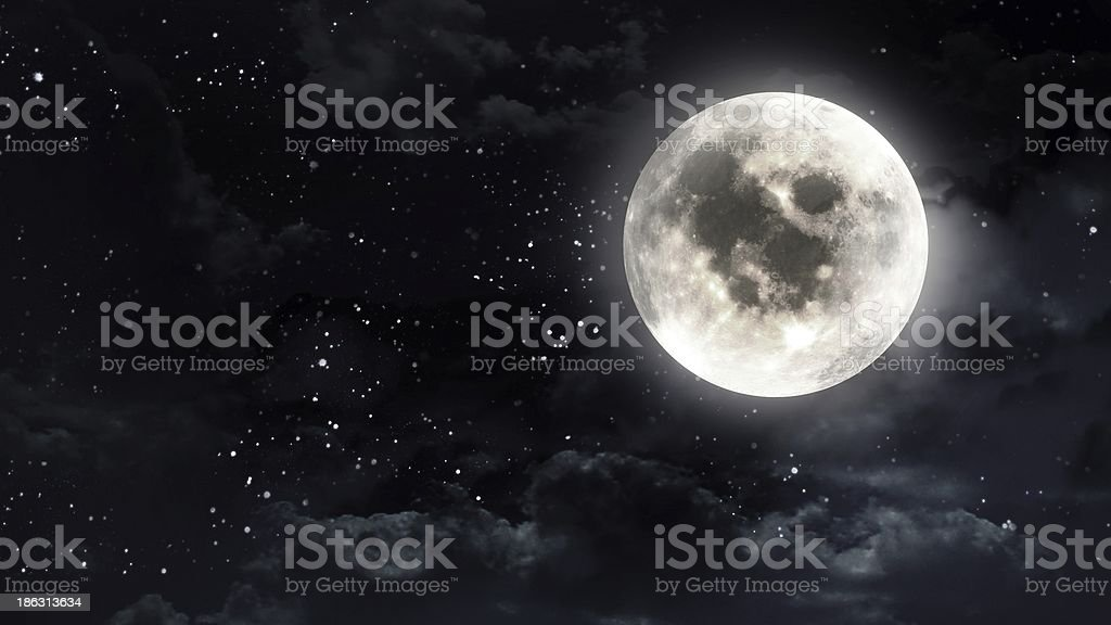 Full moon in the dark night sky stock photo