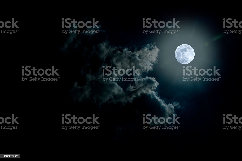 Full moon on cloudy day. stock photo