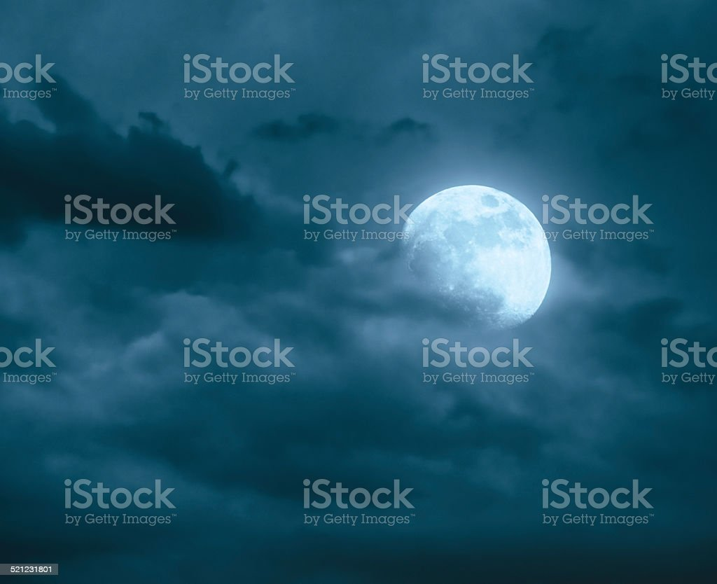 Full moon on cloudy sky stock photo