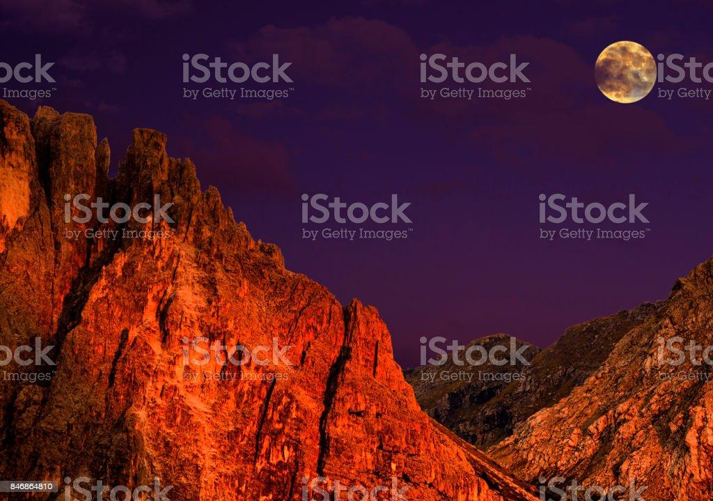 Full moon on Sella Mountain Group, Dolomites Alps, Italy stock photo