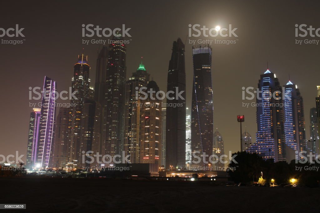 Full moon on the top of Skyscrapers stock photo