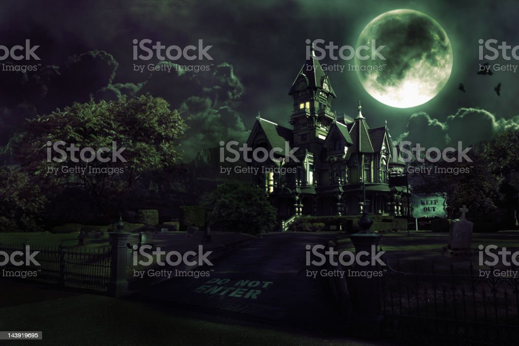 Full Moon Over Haunted House with Graveyard for Halloween royalty-free stock photo