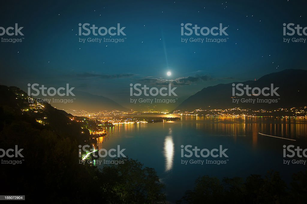 full moon over lake maggiore in Switzerland stock photo