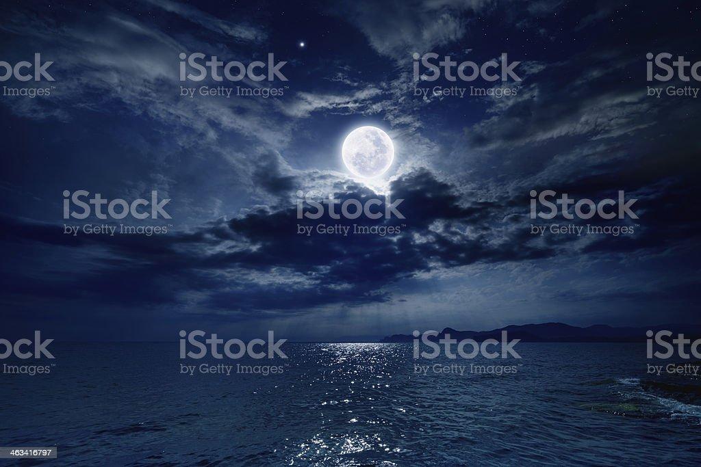 Full moon over sea stock photo