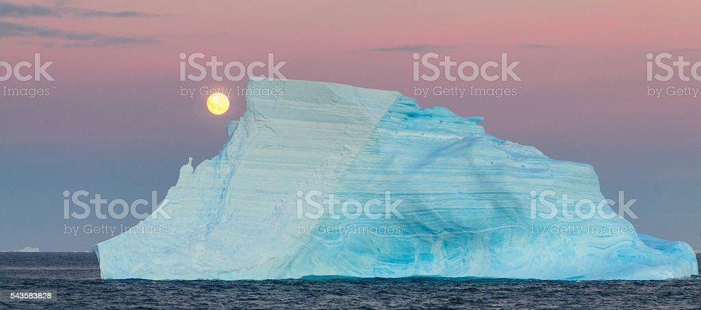 Full moon over the Antarctic stock photo