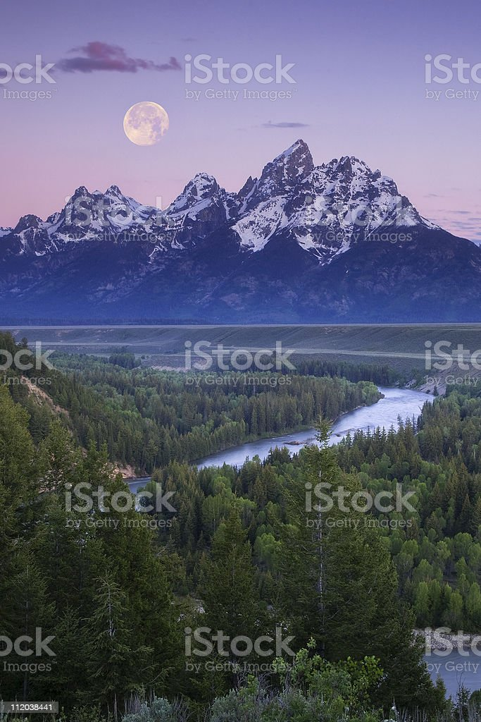 Full Moon over the Grand Tetons stock photo