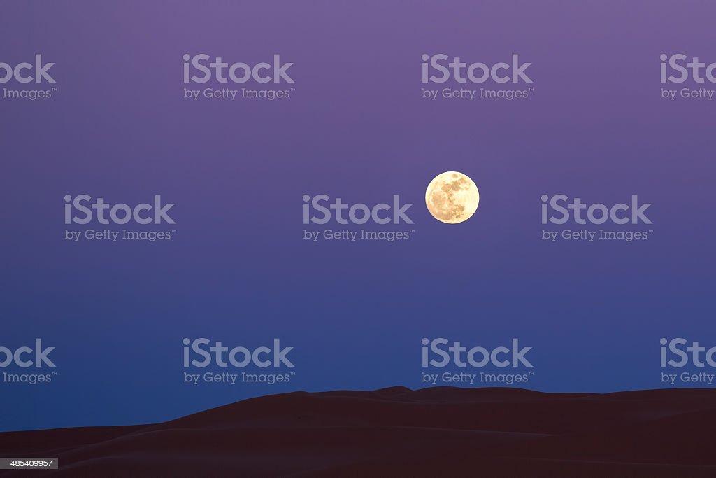 Full moon over the sahara desert dunes stock photo