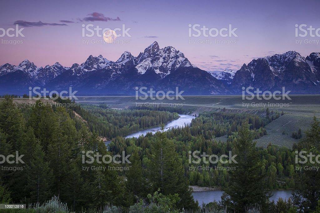 Full Moon Over the Teton Peaks stock photo