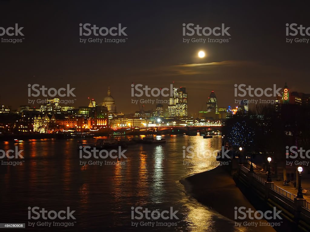 Full Moon Over the Thames at Night stock photo