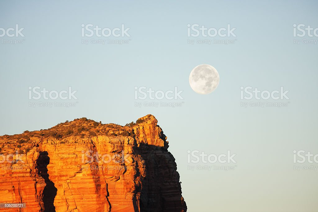 Full Moon Red Rock Butte Sunrise stock photo