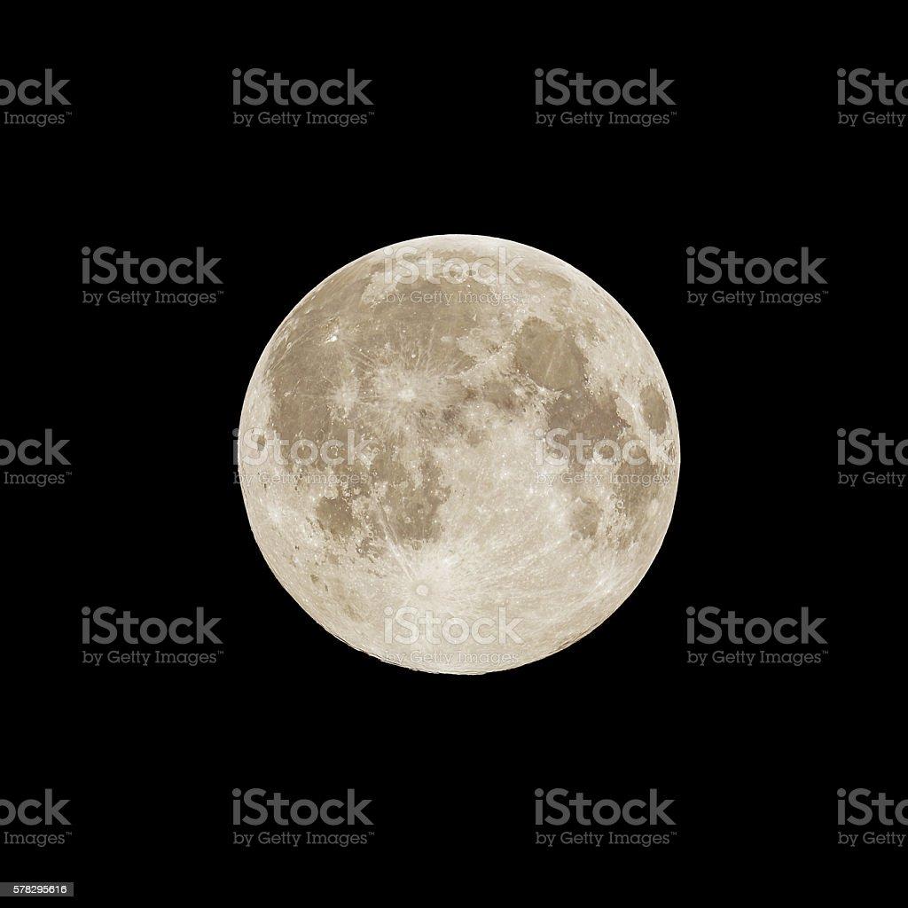 Full moon rising, delicate sepia color stock photo