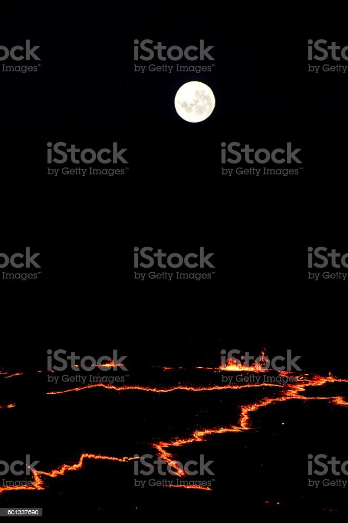 Full moon rising over Erta Ale volcano , danakil depression Ethiopia stock photo