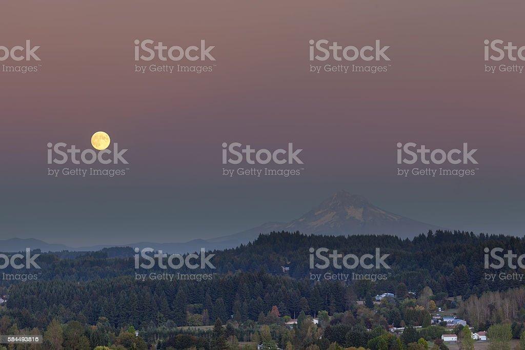 Full Moon Rising Over Mount Hood stock photo