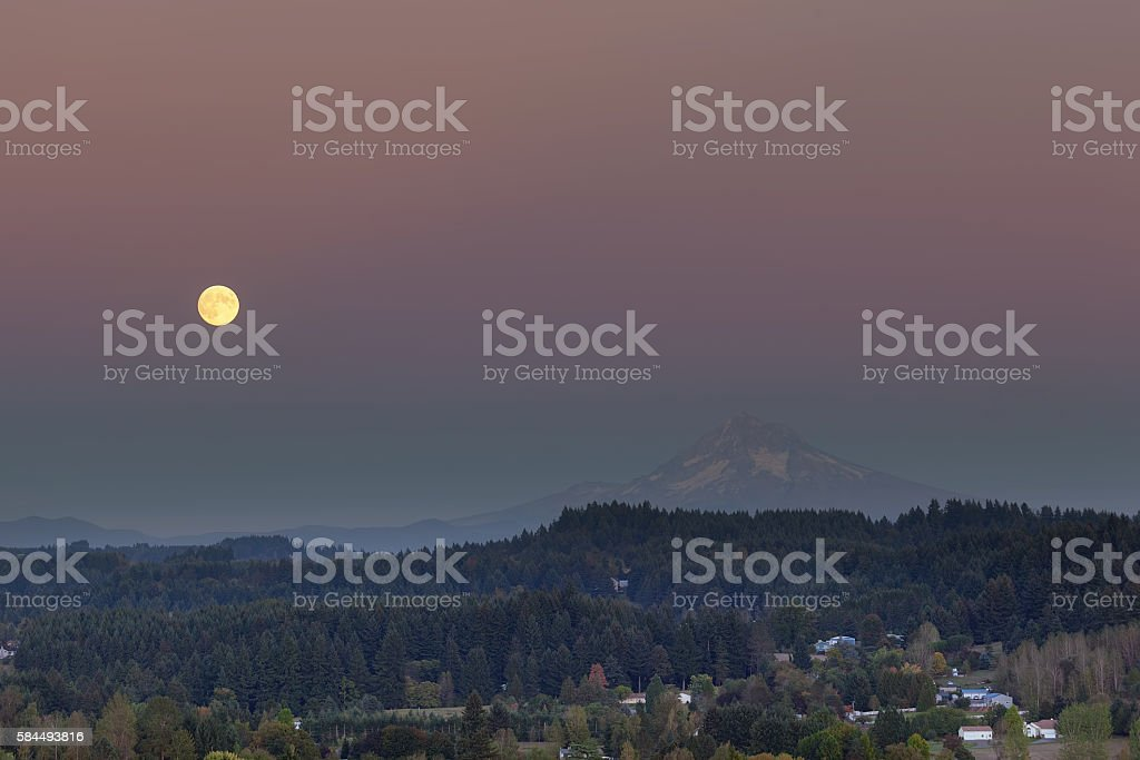 Full Moon Rising Over Mount Hood stock photo