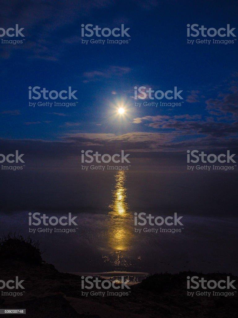 Full Moon Sets stock photo