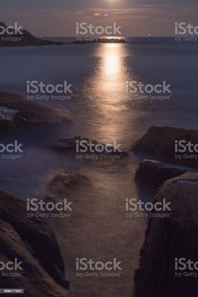 full moon sunset stock photo