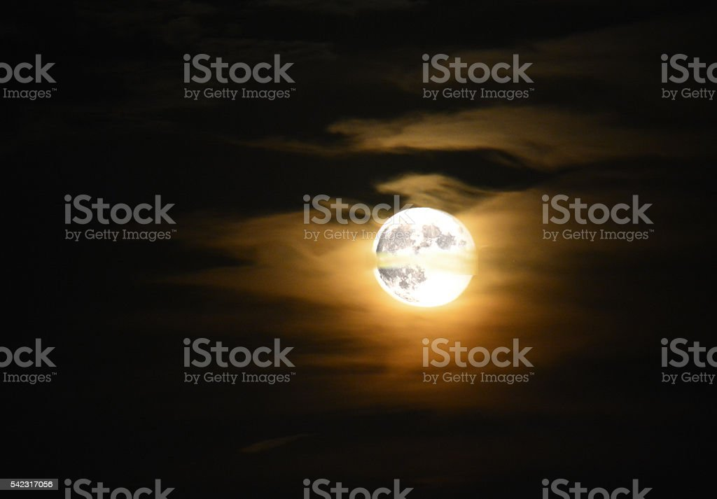 Full Moon Surface in orange clouds shining stock photo