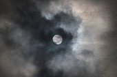 Full moon with clouds and lunar halo