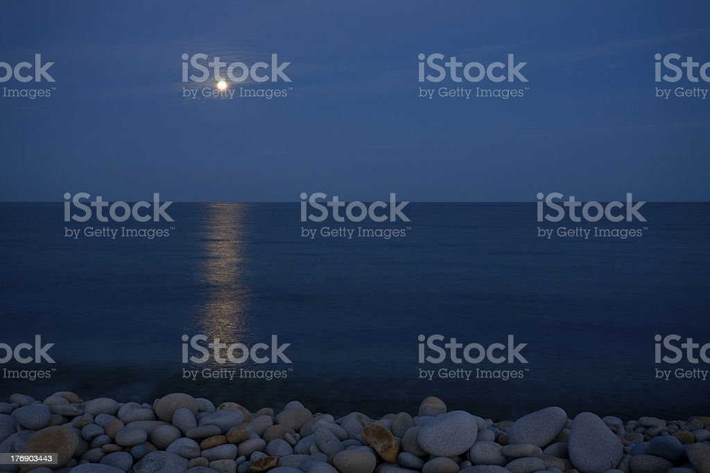 Full moon with reflection on sea royalty-free stock photo