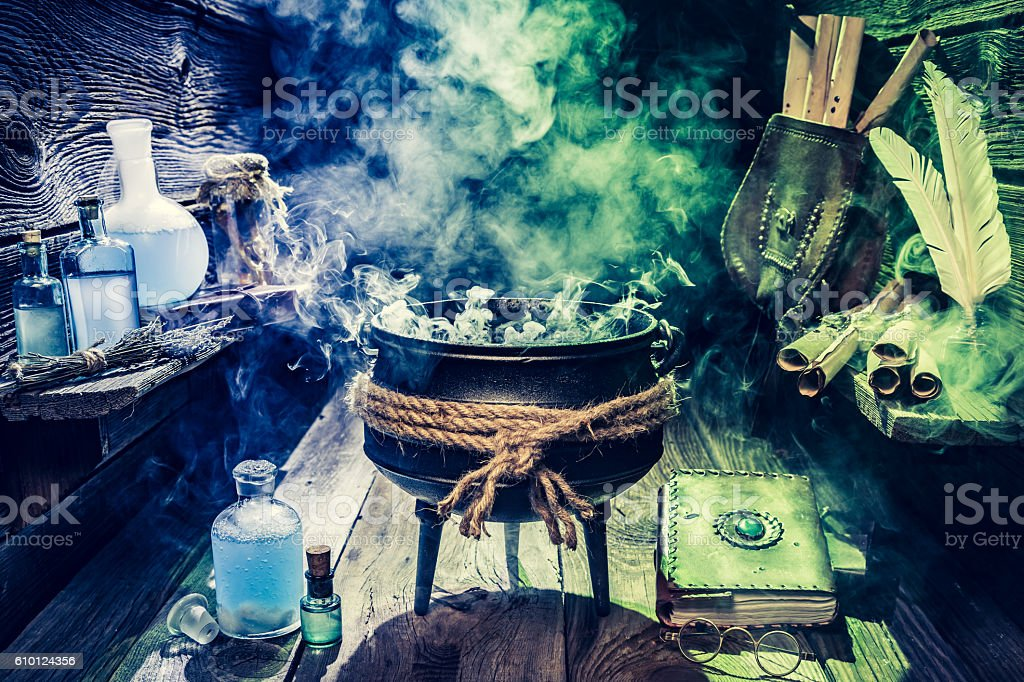 Full of magic mixture witch pot with blue potions stock photo