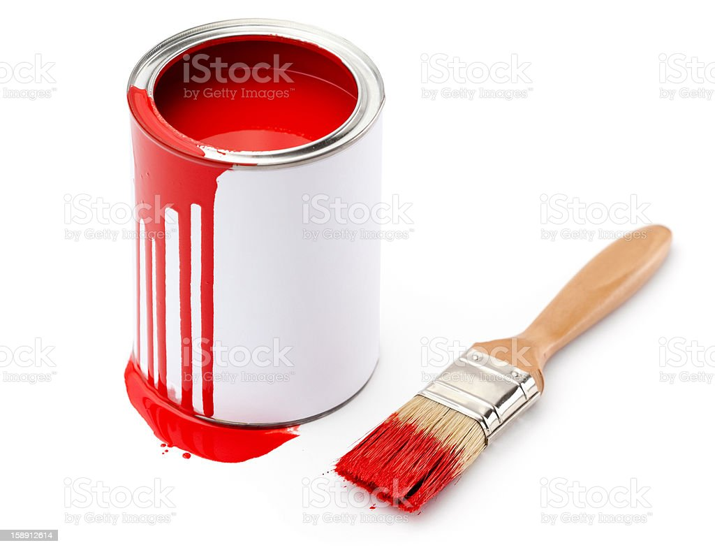 Full of red paint tin near the paintbrush stock photo