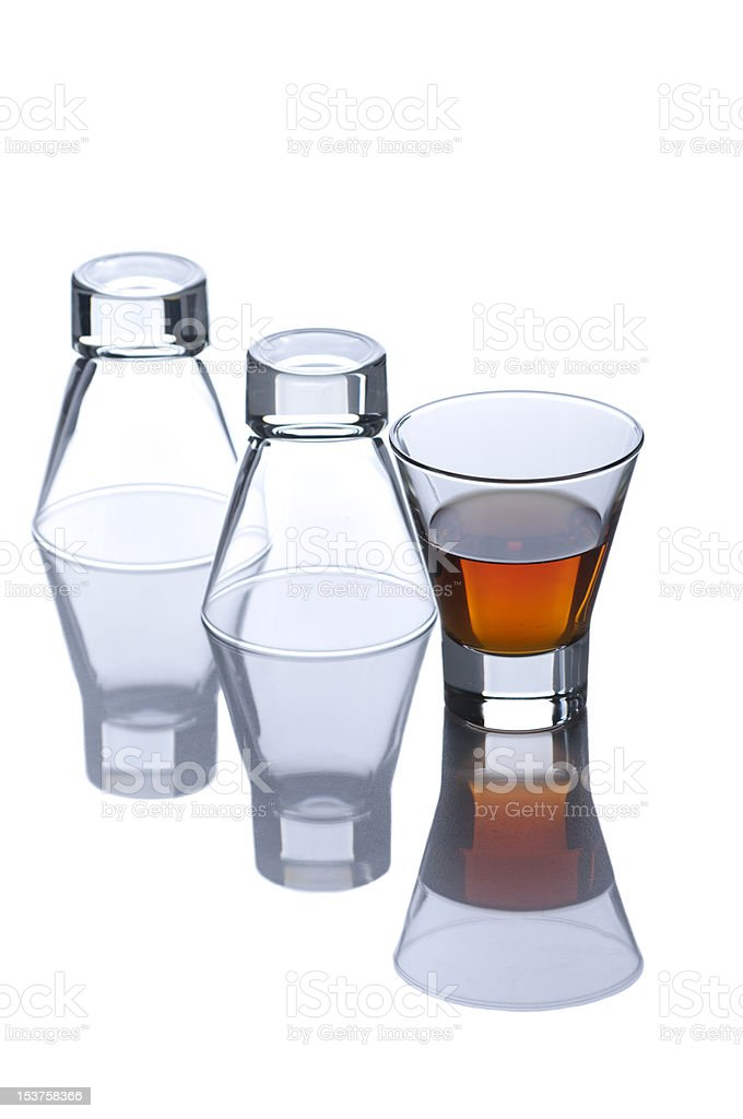 Full of rum and two upside down glasses on white royalty-free stock photo