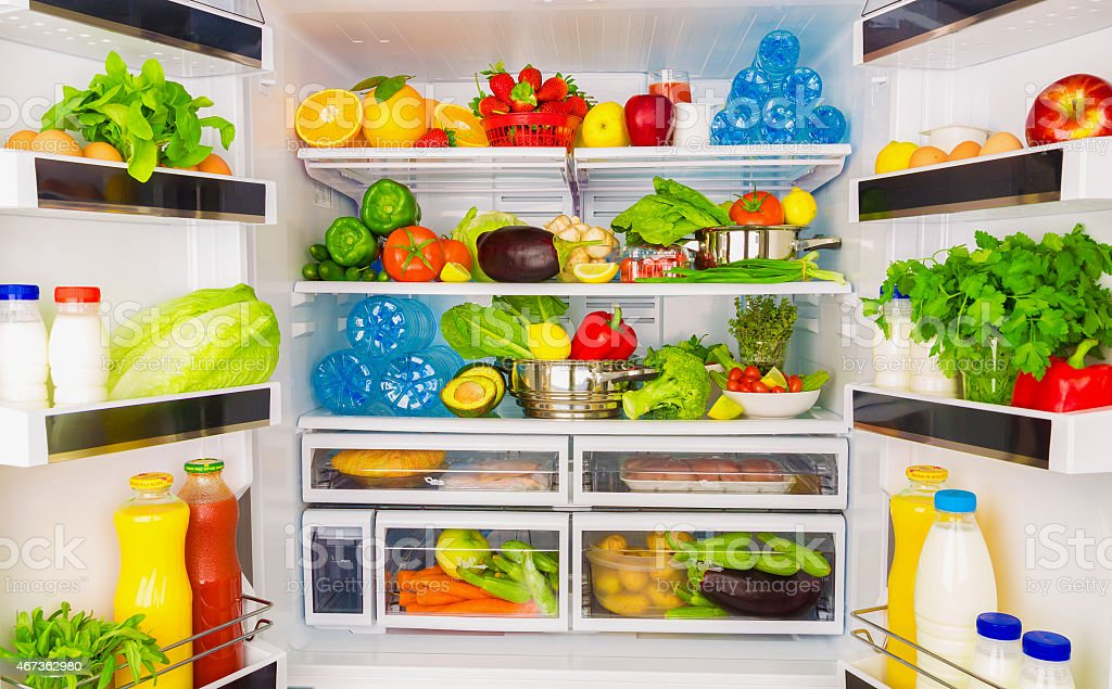Full open fridge with lots of vegetables stock photo