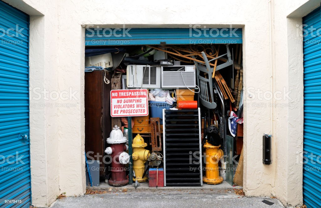 Full Overflowing Storage Unit Bursting with Heap of Junk stock photo