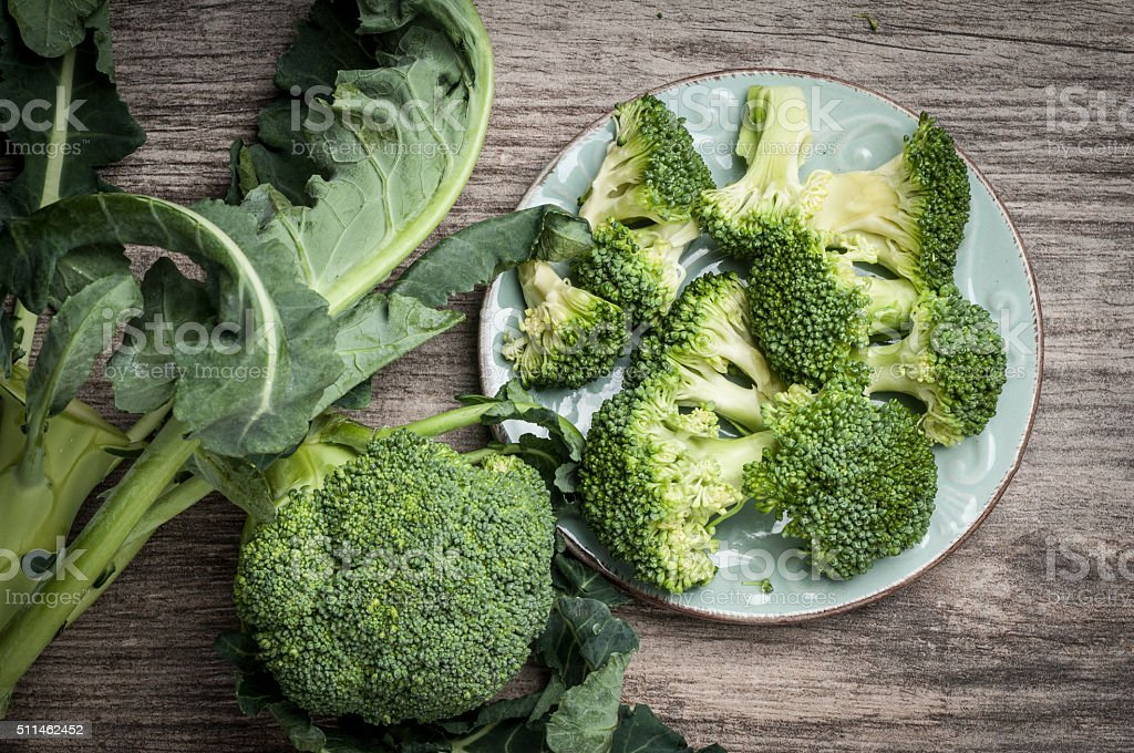 Full plate of raw broccoli stock photo