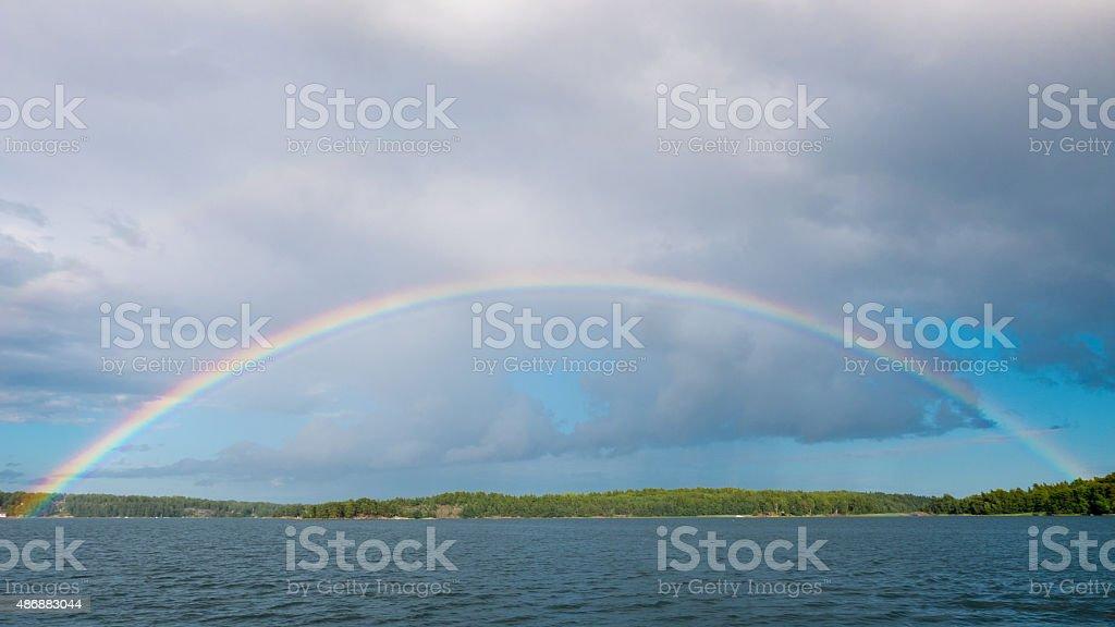Full rainbow arc stock photo