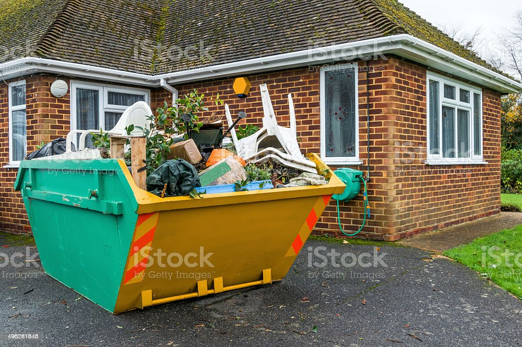 Full rubbish skip stock photo