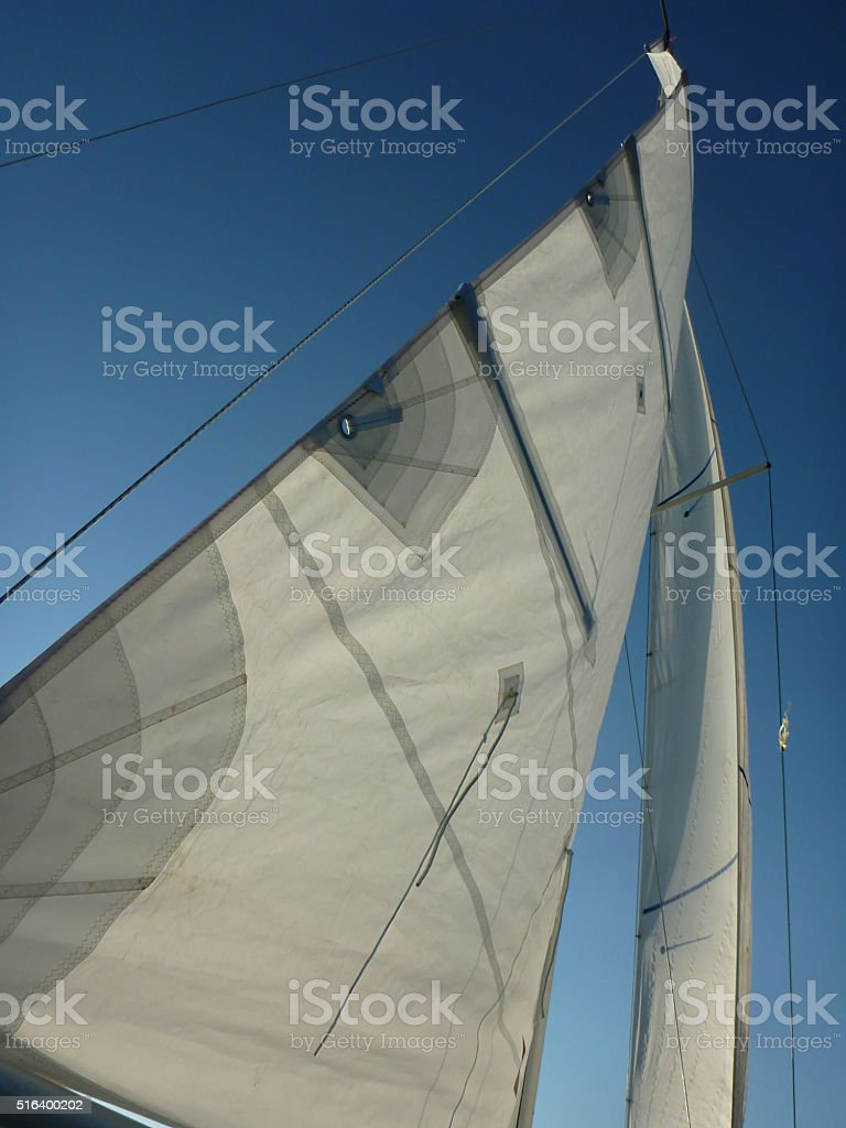 Full sails on a sailing boat stock photo