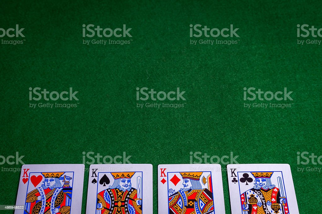 Full set of King Playing cards on green felt background stock photo