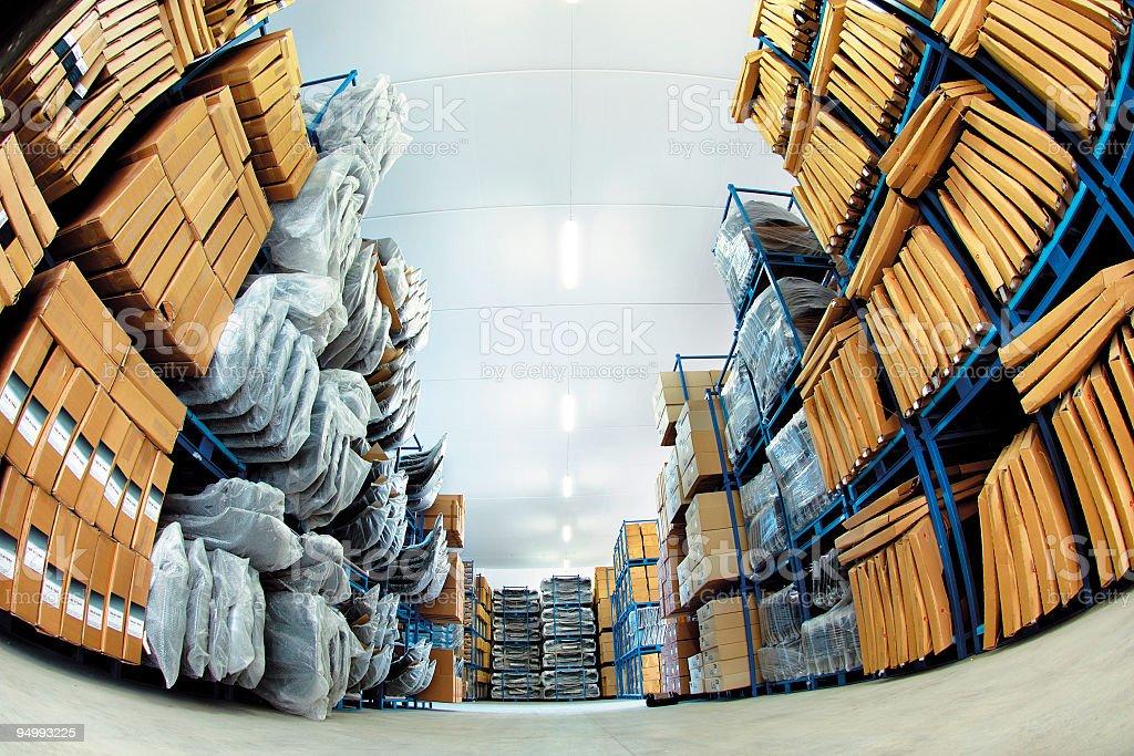 Full shelves in storehouse of italian manufacturing company, fisheye lens stock photo