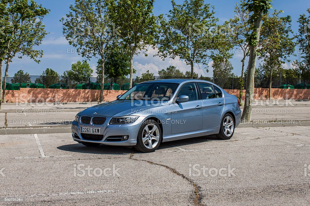 Full shot BMW 320D blue. Urban scene. stock photo