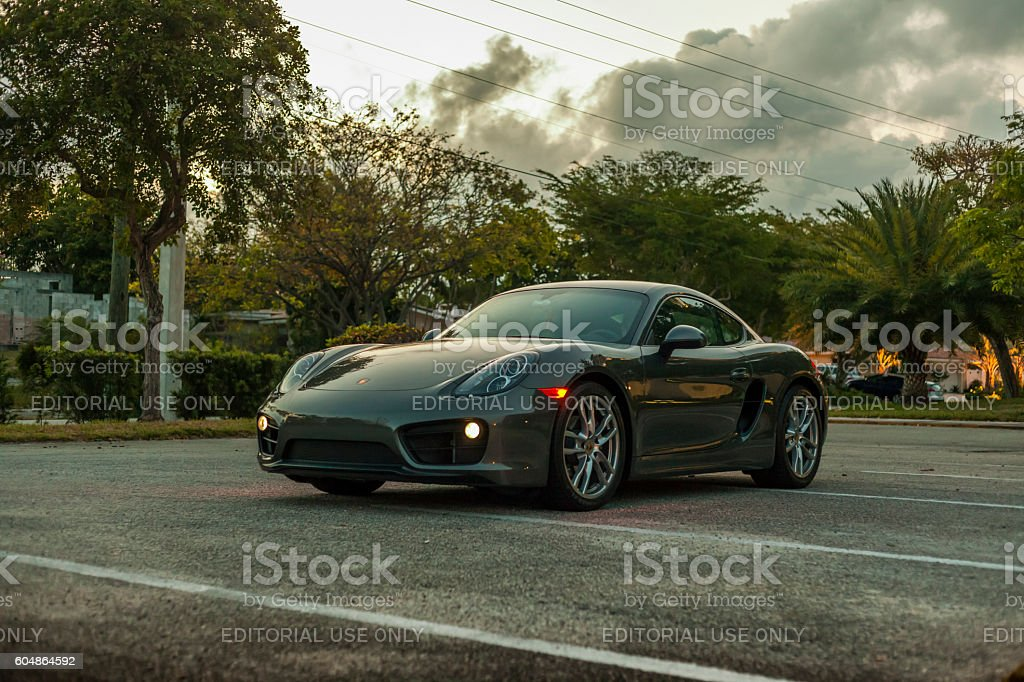 Full shot Porsche Cayman by night in residential area stock photo