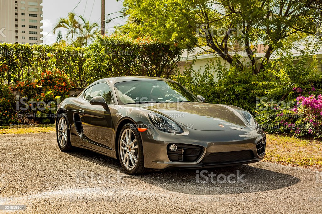 Full shot Porsche Cayman in residential area stock photo
